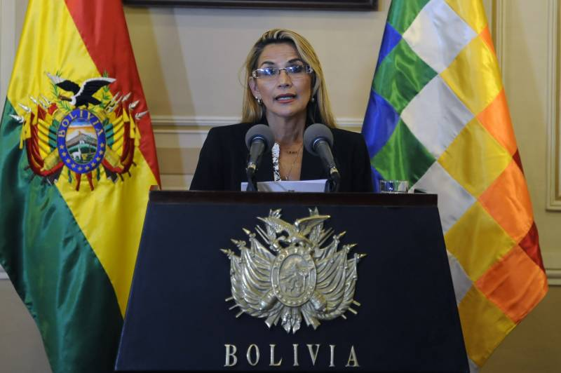 Under-fire Bolivia leader bolsters cabinet ahead of poll