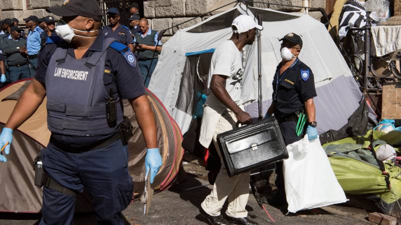 South African police evict migrant squatters from Cape Town's busy square