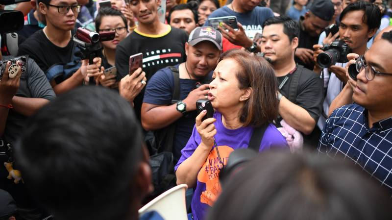 Malaysian police quiz Mahathir's daughter over protest
