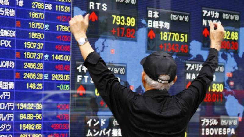 Asian markets build on gains as central banks kick into gear