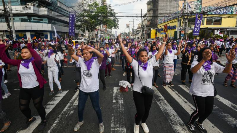 Thousands rally in Asia for Women's Day despite virus fears