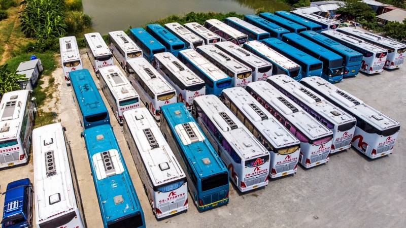 Tour buses idle as Thai economy takes gut punch from virus
