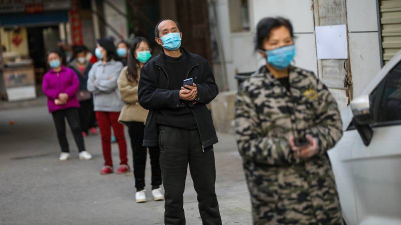 Wuhan waits for barriers to come down as virus storm subsides