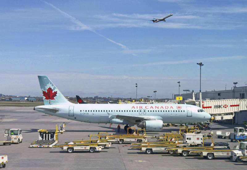 Air Canada to temporarily lay off 5,000 flight attendants