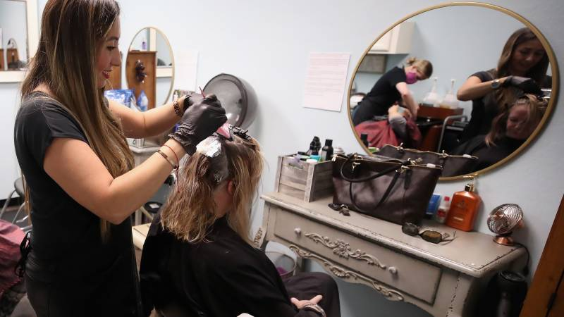 To cut or not to cut? In US, quarantine slows everything but hair growth