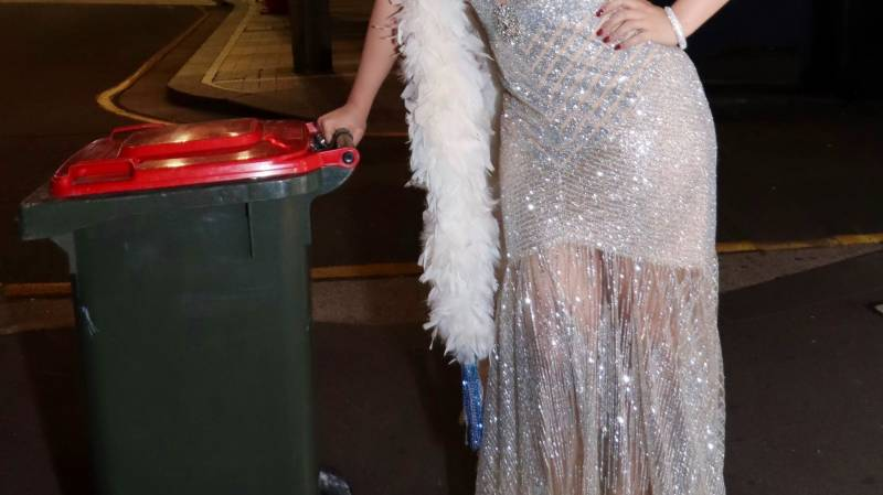 Trashy fashion: dressing up to take the bins out in virus lockdown