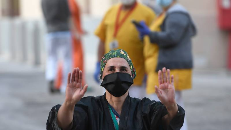 Cautious hope for pandemic peak as Spain readies to reopen some factories