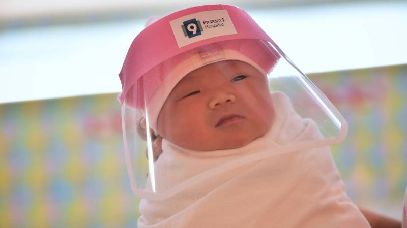 Thai medics protect babies born in a pandemic with face shields