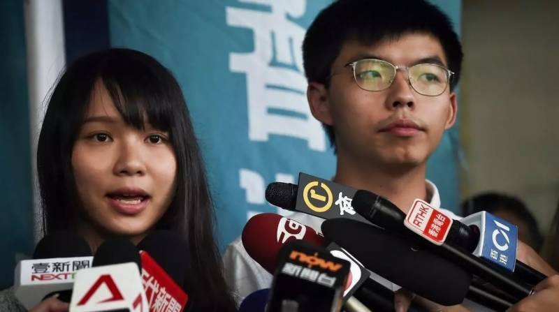 Hong Kong activists arrested over last year's democracy rallies