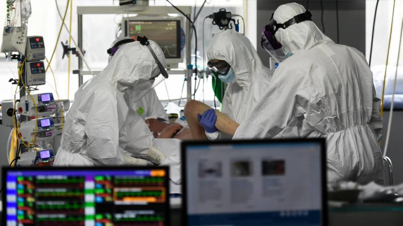 Spain records lowest daily virus toll in a month