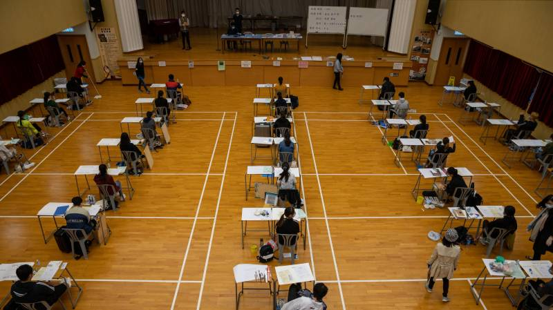 Hong Kong holds virus-delayed exams with strict health checks