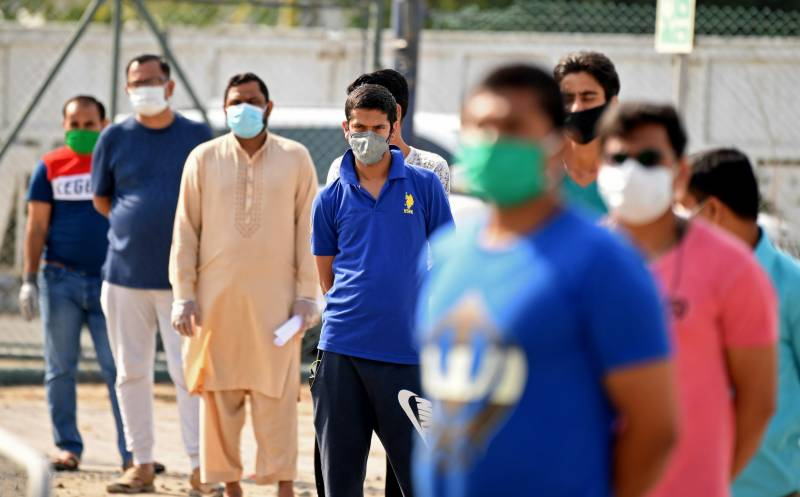 Sick, stranded and broke: crisis hits Gulf's migrant workers