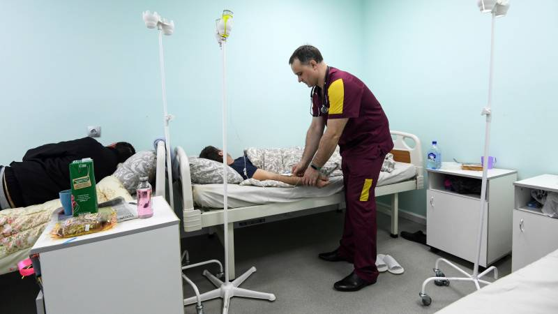 Russia sees record rise as virus cases surge past 100,000