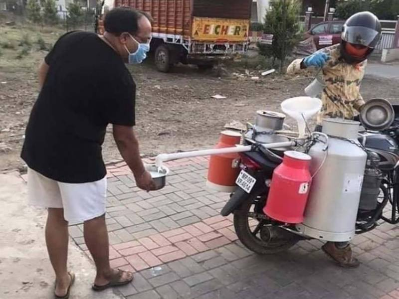 Indian milkman comes up with 'invention' to maintain social distance