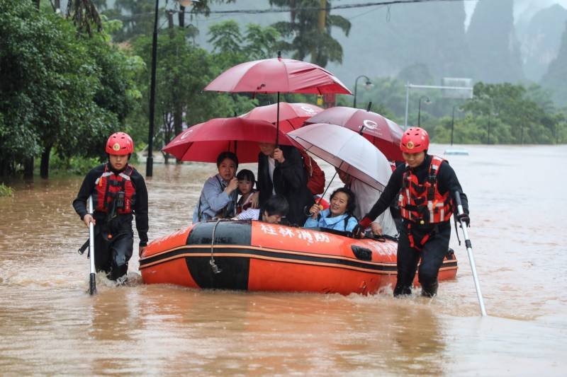 Dozens killed as south China hit by floods and rainstorms