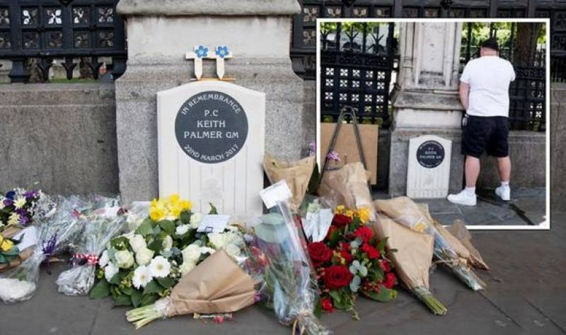 London police arrest man suspected of disgracing officer's memorial