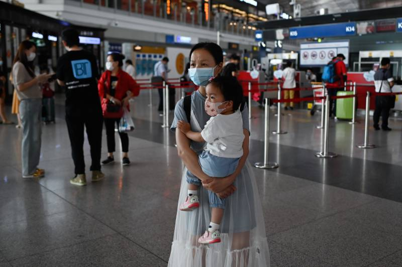 Beijing cancels flights, shuts schools over new virus outbreak
