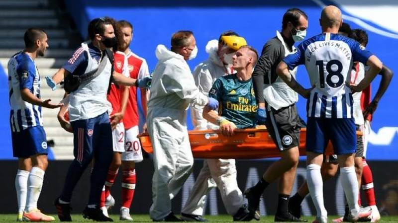 Arsenal keeper Leno stretchered off in agony off at Brighton