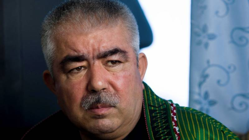 Afghan warlord accused of rights abuse awarded highest military rank