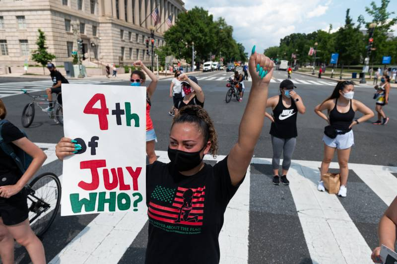 Independence Day marked by division on the streets of Washington
