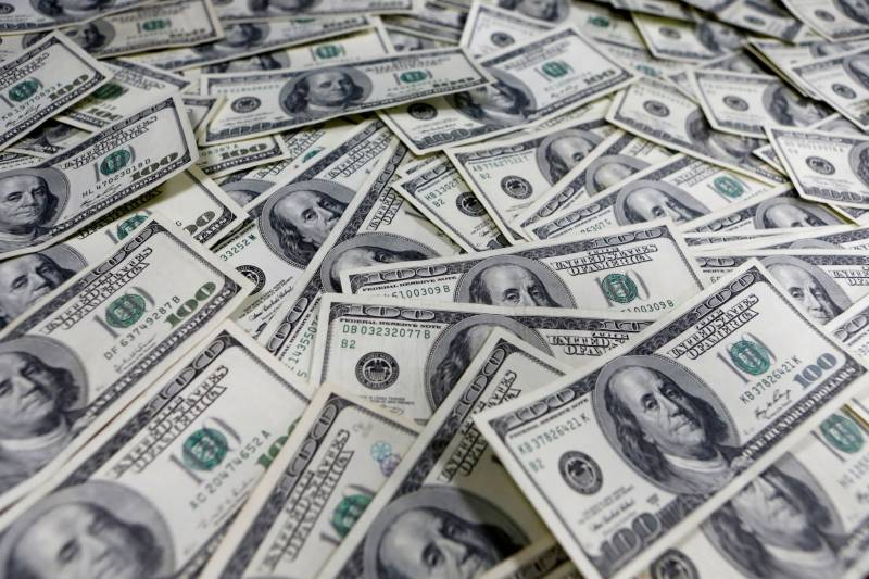 Dollar down 38 paisas, available for Rs166.20