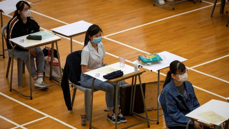 Hong Kong to shut all schools after virus cases spike