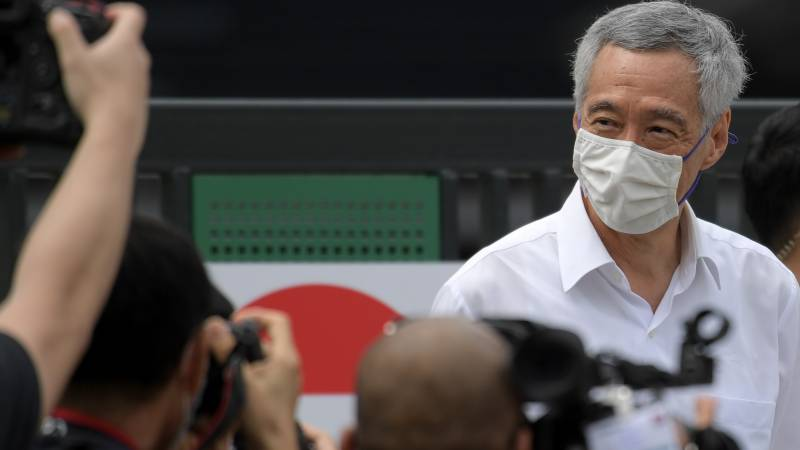 Singapore ruling party retains power but support slips in pandemic poll