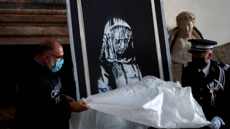 Stolen Banksy returned to France from Italy