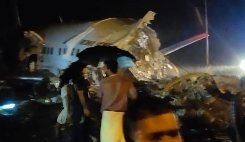 Air India plane breaks into two after crash landing, pilot among 16 dead