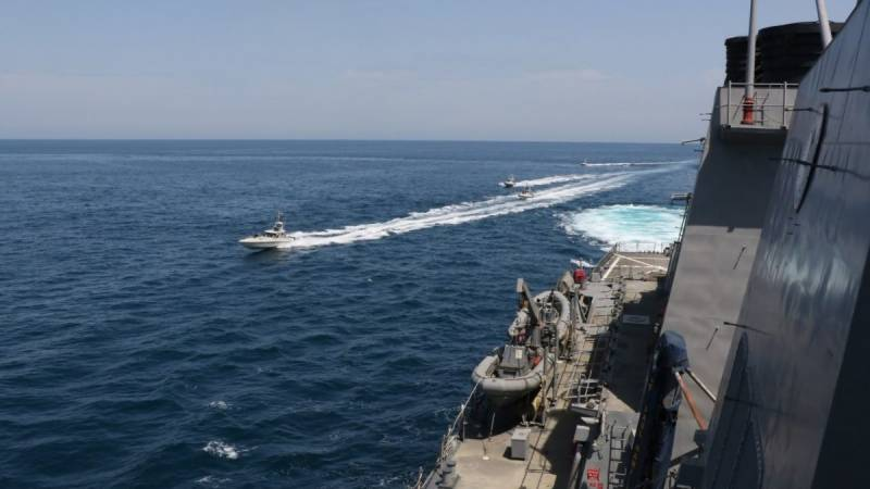 US says Iran forces board ship in international waters