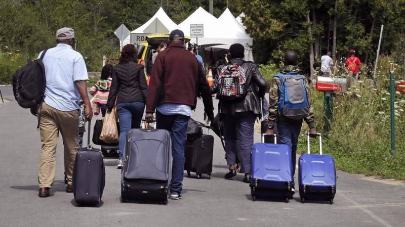 Asylum seekers on virus frontlines to get Canada residency