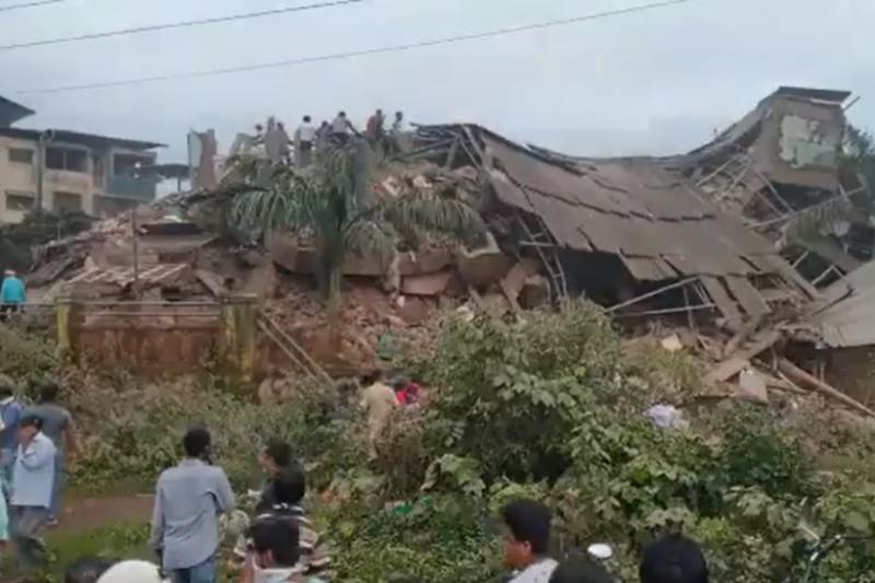 At least 70 feared trapped in India building collapse: police