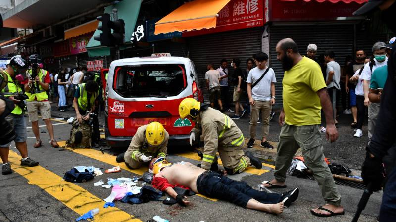Hong Kong court throws out private case against officer who shot protester