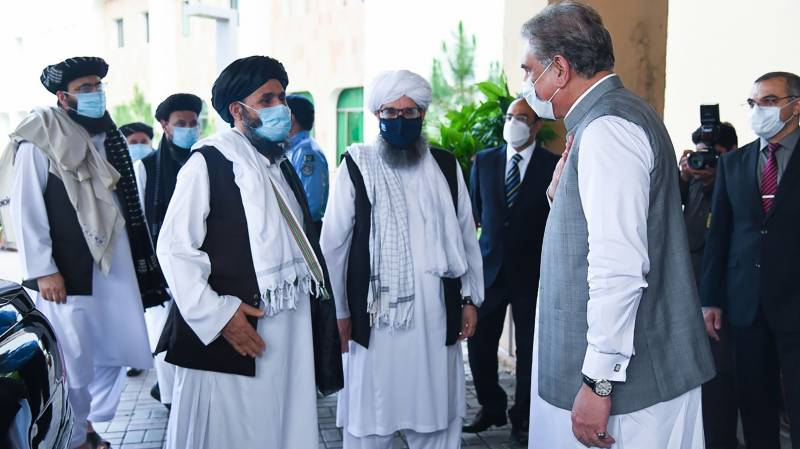 Visiting Taliban delegation discusses Afghan peace process with Qureshi