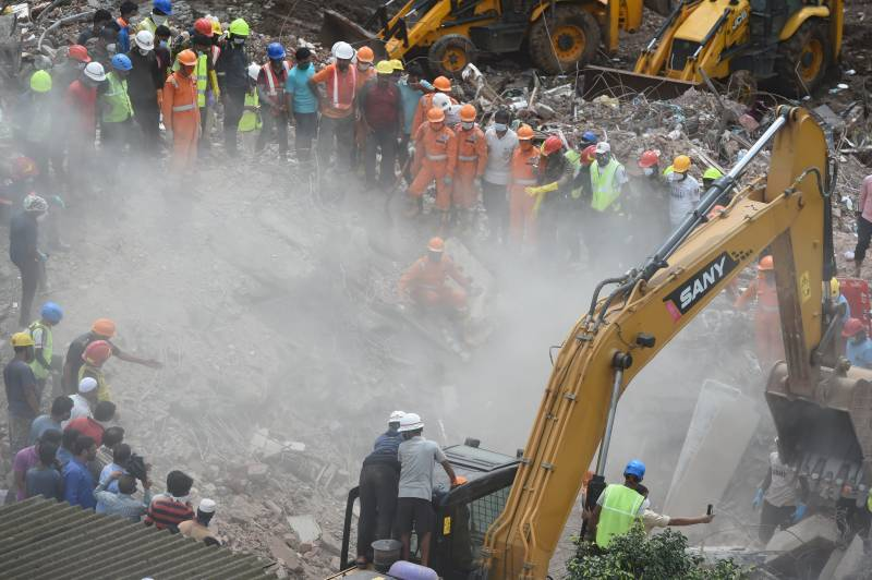 India rescuers pull 4-year-old survivor from collapsed building