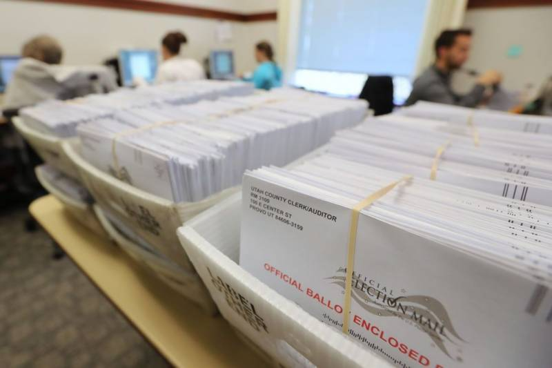 US vote-by-mail begins as White House campaign gets ugly