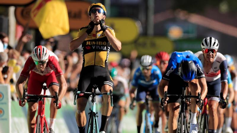 Van Aert wins wind-blown stage seven of Tour de France