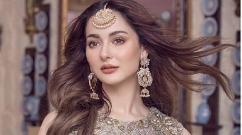 Hania Aamir looks gorgeous in golden and black saree