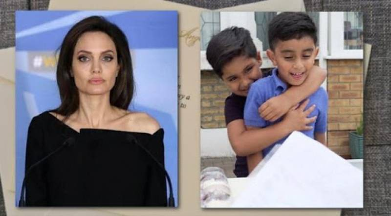 Angelina Jolie helps young boys running lemonade stand for Yemen aid