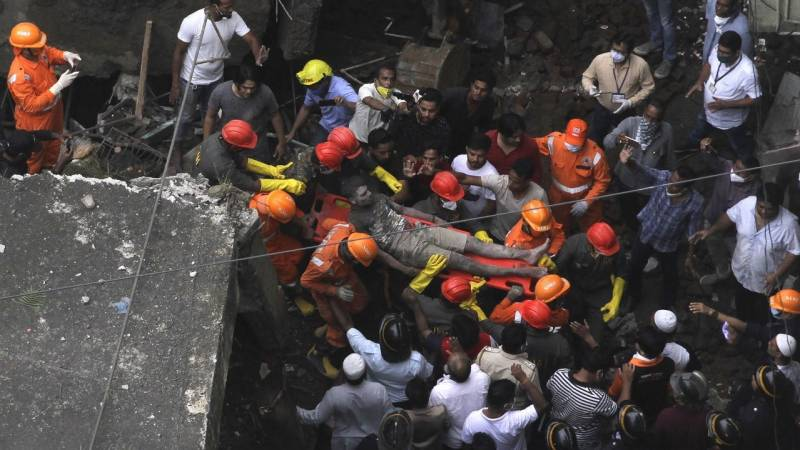 At least 13 dead, 25 feared trapped, in India building collapse