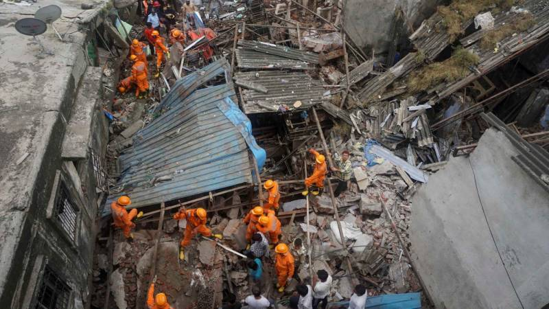 Rescuers find five alive, over 30 hours after India building collapse