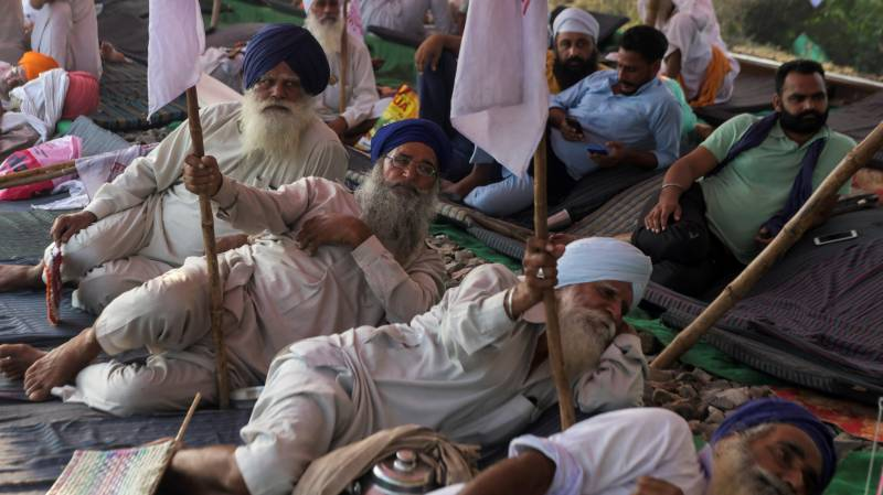 Farmers block rails and roads in India to protest new bills