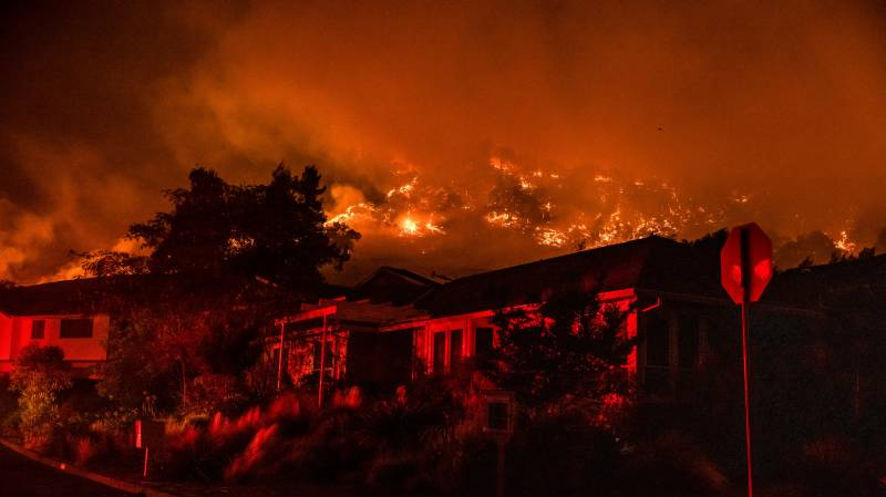 Tens of thousands flee wildfires roaring through California wine regions