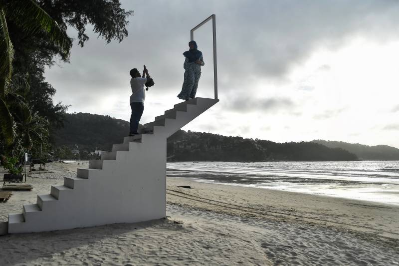 'Ghost island' Phuket hunkers down in tourist-free Thailand