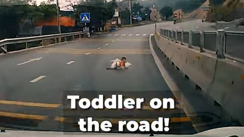 This toddler was crawling on the highway...!