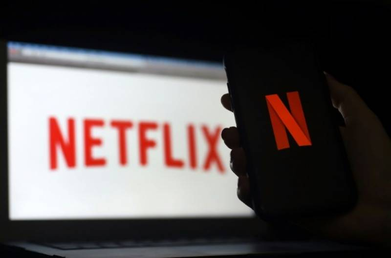 Netflix reports slowing subscriber growth; shares slide