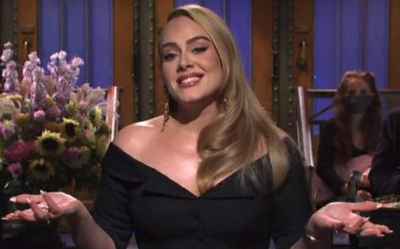 Adele sings and jokes about weight loss as she hosts Saturday Night Live