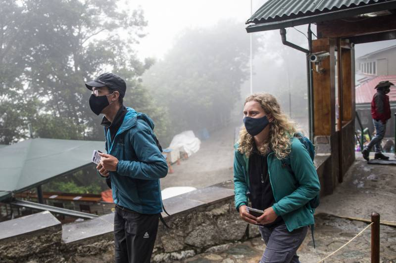 Tourists return to misty Machu Picchu after months of isolation