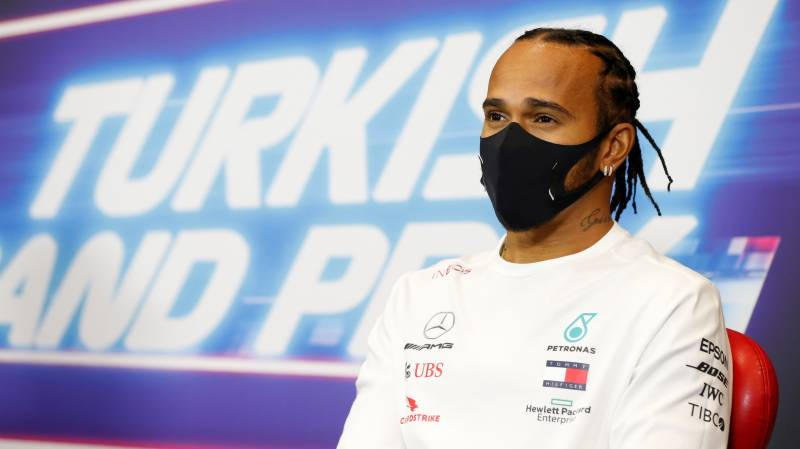 Enigmatic Hamilton says he is ready to race on next year