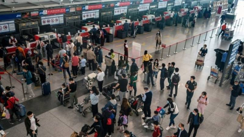 Hundreds of flights cancelled as Shanghai tackles virus outbreak